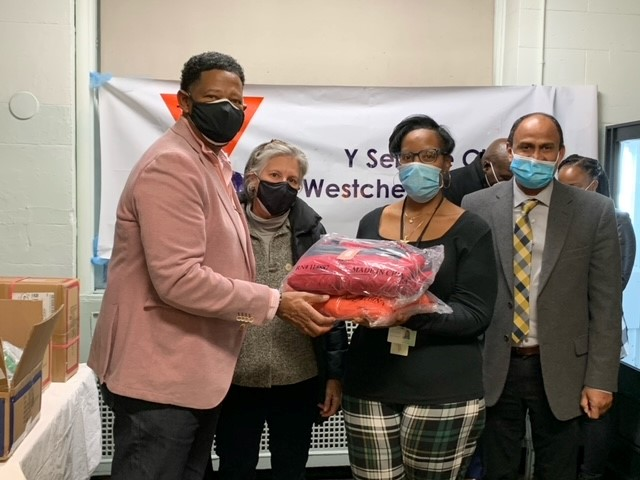 Y's Men Club of Westchester County donates coats to 138 homeless
